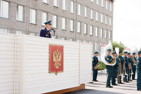 advocates: The militarian elderly the man on a tribune acts, grand welcome of veterans of aviation college of city of Perm
