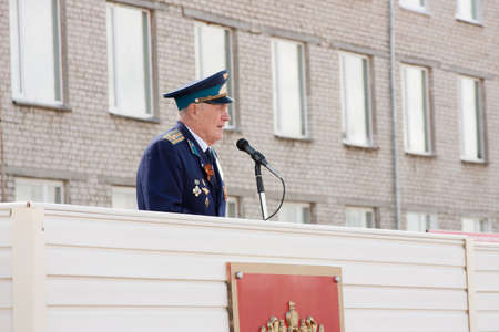 acts: The militarian elderly the man on a tribune acts, grand welcome of veterans of aviation college of city of Perm