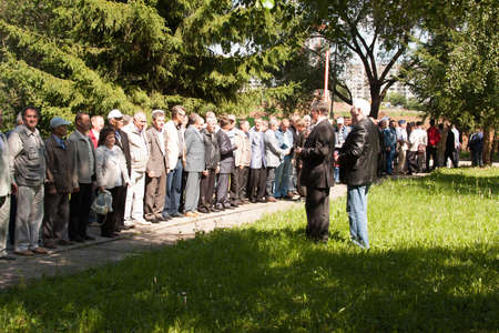alumni: People cost in a number at a meeting of veterans of aviation college of city of Perm