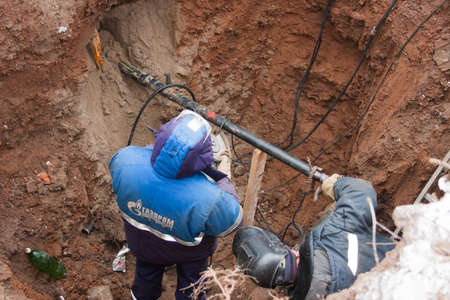 sidebar: PERM, RUSSIA, DECEMBER 15.2015: the workers make the sidebar of the gas pipe in the pipeline