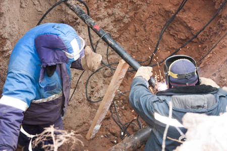 sidebar: PERM, RUSSIA, DECEMBER 15.2015: the workers make the sidebar of the gas pipe to the gas pipeline, welding