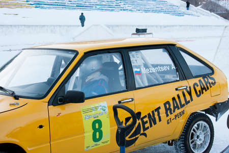 perm: PERM, RUSSIA, JANUARY 17.2016: the pilot in the cabin of a racing car preparing to rally