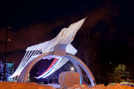 mig: PERM, RUSSIA, JANUARY 17.2016 Monument MiG on the rise about OAO Perm Motors decorated Christmas garland night