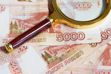 gilt: The magnifier in the gilt frame lays on the Russian money