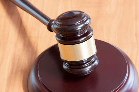 judicial: Judicial hammer with a support on a wooden table