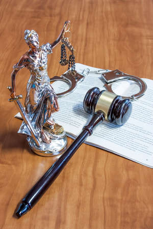 russian federation: A statuette of Themis, the constitution of the Russian Federation, handcuffs and gavel on the table