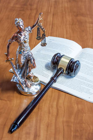 russian federation: A statuette of Themis, the constitution of the Russian Federation and the gavel on the table