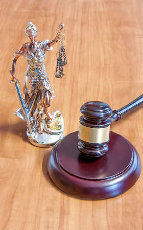 themis: Themis Figurine and gavel on the table