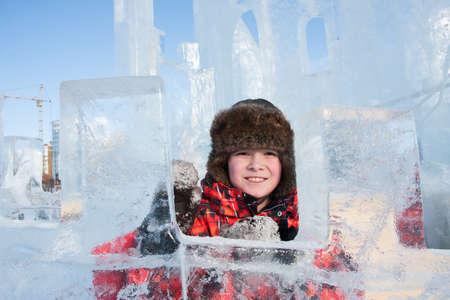 PERM, RUSSIA, Feb, 06.2016: Boy with an ice sculpture, urban esplanade, Lenin Street