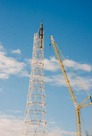 PERM, RUSSIA, Feb, 06.2016 Construction of a new communications tower against a blue sky