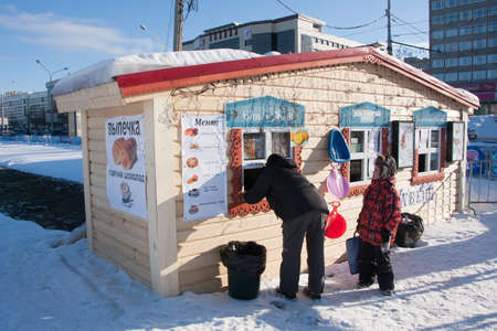 lenina: PERM, Russia, February, 06.2016: people buy food at fast food in an icy town on the Esplanade,   Lenina Street Editorial