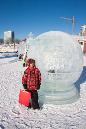 ice sculpture: PERM, RUSSIA, Feb, 06.2016: Boy stands in a round of ice sculpture, urban esplanade, Lenin Street