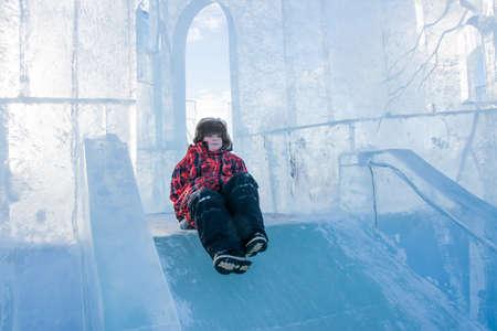 lenin: PERM, RUSSIA, Feb, 06.2016: Boy riding a frozen hill, urban esplanade, Lenin Street
