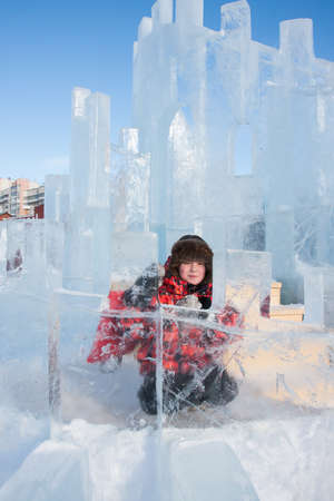 ice sculpture: PERM, RUSSIA, Feb, 06.2016: Boy with an ice sculpture, urban esplanade, Lenin Street