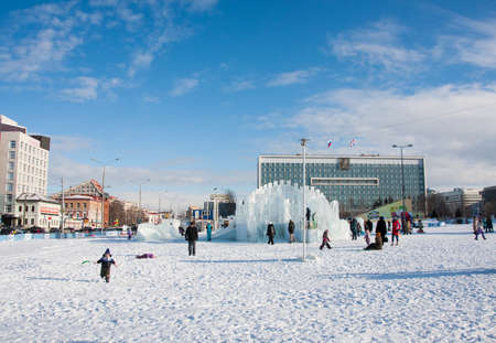 lenina: PERM, Russia, February, 06.2016: adults with children in an icy town on the Esplanade,   Lenina Street Editorial