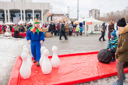 perm: PERM, RUSSIA - March 13, 2016: Children playing skittles at the celebration of Carnival