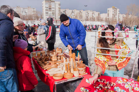 perm: PERM, RUSSIA - March 13, 2016: Trade counters with decorative woodwork on the celebration of Carnival