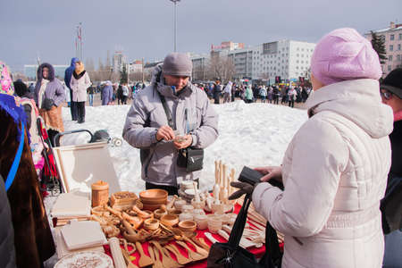 perm: PERM, RUSSIA - March 13, 2016: Trade stalls of wood products during the celebration of Carnival