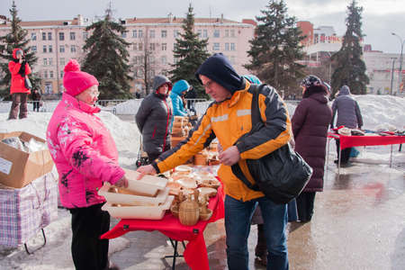 gamme de produit: PERM, RUSSIA - March 13, 2016: Trade counters with decorative woodwork on the celebration of Carnival