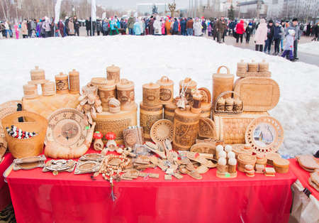 product range: PERM, RUSSIA - March 13, 2016: Trade stalls with products from birch bark on celebrating Shrovetide Editorial