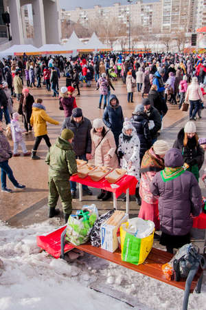 perm: PERM, RUSSIA - March 13, 2016: A lot of people in the square, the celebration of Carnival