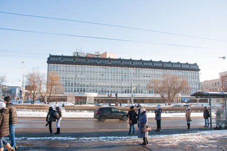 lenin: PERM, RUSSIA - March 13, 2016: People stand at a bus stop, Lenin Street