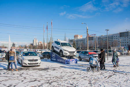 13: PERM, RUSSIA - March 13, 2016: Cars on the esplanade, Lenin Street