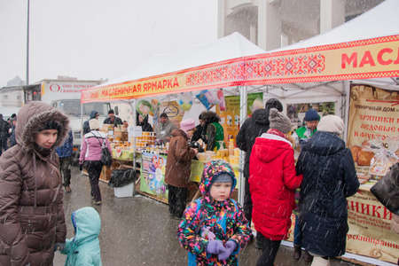 product range: PERM, RUSSIA - March 13, 2016: Shoppers at Shrovetide fair in snow Editorial