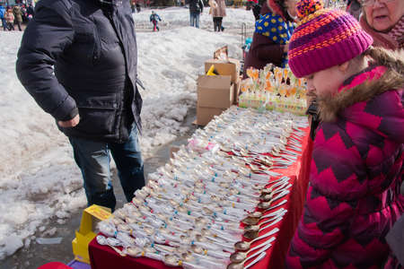perm: PERM, RUSSIA - March 13, 2016: Trade stalls with silver spoons in celebration of Maslenitsa Editorial