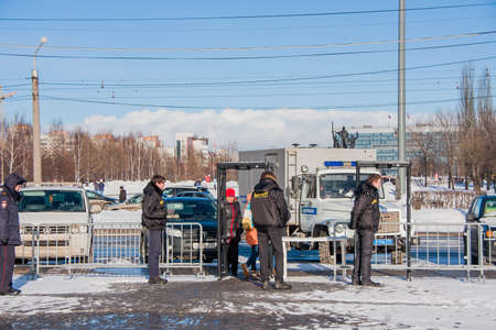 PERM, RUSSIA - March 13, 2016: Security at the entrance to the esplanade, the celebration of Carnival