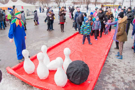PERM, RUSSIA - March 13, 2016: Children playing skittles at the celebration of Carnival
