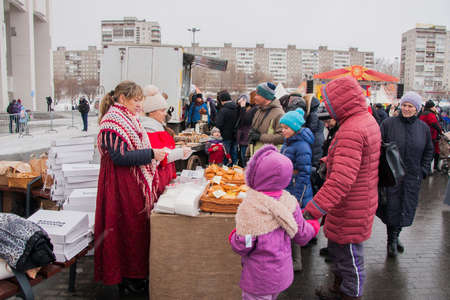 PERM, RUSSIA - March 13, 2016: People buy fresh pastries, celebrating Shrovetide