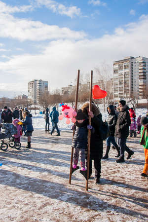 PERM, RUSSIA - March 13, 2016: Girl on stilts, the celebration of Carnival Editorial