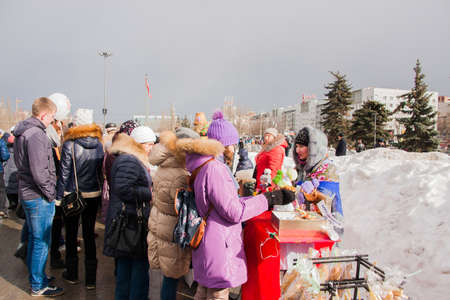 PERM, RUSSIA - March 13, 2016: Trade stalls selling toys at the celebration of Carnival Editorial