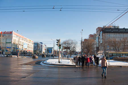 PERM, RUSSIA - March 13, 2016: People crossing the road on a green traffic light signal Editorial