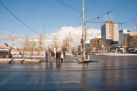 PERM, RUSSIA - March 13, 2016: People stand at the crossroads and wait for the green light Editorial