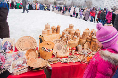 PERM, RUSSIA - March 13, 2016: Trade stalls with products from birch bark on celebrating Shrovetide Editorial