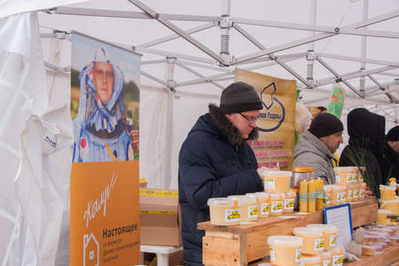 13: PERM, RUSSIA - March 13, 2016: Trade honey at the celebration of Carnival