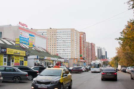 Perm, Russia - September 28.2016: Trading pavilions and the traffic in streets of city Editorial