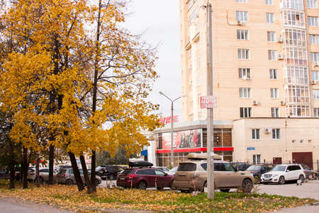 Perm, Russia - September 28.2016:  Autumn city landscape and a parking of cars at shop