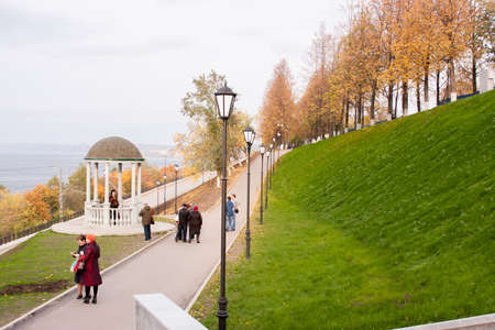 Perm, Russia - September 28.2016: Alley on embankment the river Kama with a rotunda autumn day Editorial