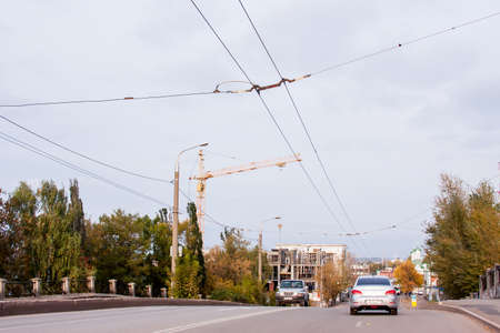 Perm, Russia - September 28.2016: Autumn cityscape with the construction of the shopping center and the road