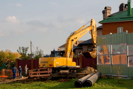 Perm, Russia - September 26.2016: Excavator working around the new cottage
