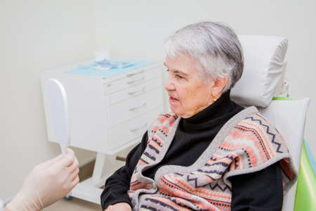 he elderly woman on prosthetics of a teeth at the orthopedist Stock Photo