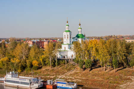 Tyumen, Russia - October 01.2016: Ascension, St. Georges Church and pleasure boats by the river
