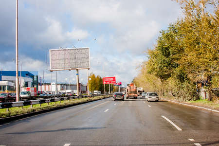 Ekaterinburg, Russia - October 02.2016: Traffic of cars on a line with the blue cloudy sky