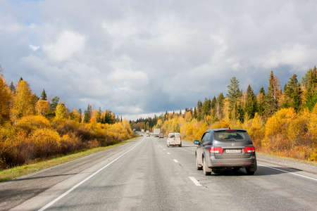 Revda, Russia - October 02.2016: Traffic of cars on a line in an autumn sunny day