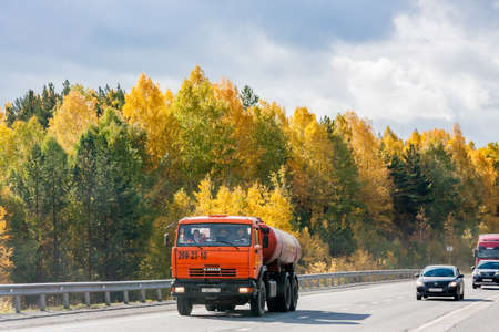 Yekaterinburg, Russia - October 02.2016: Traffic trucks and autumn landscape along the route