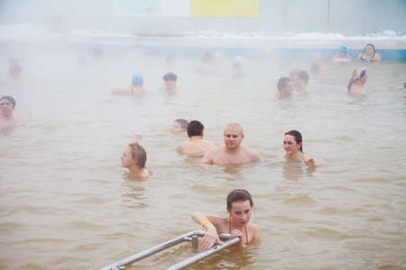 Tyumen, Russia - November 05.2016: People in pool with hot mineral water in winter, a thermal source  Soviet  Editorial