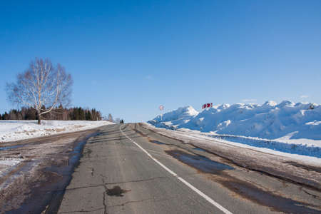 Winter landscape with road and forest, Russia Stock Photo